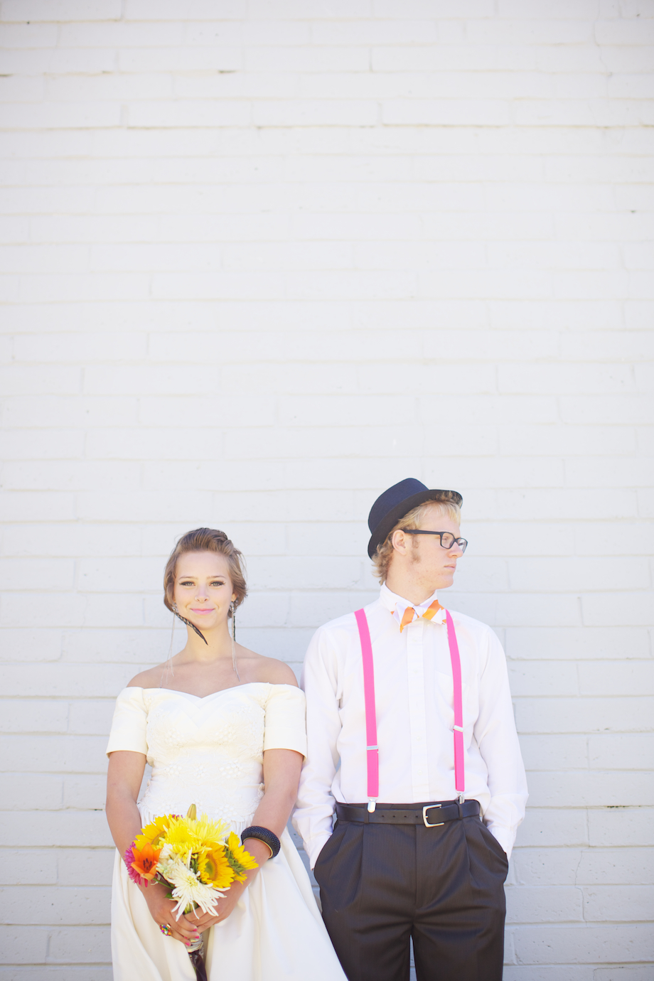 white brick wall and a wedding portrait