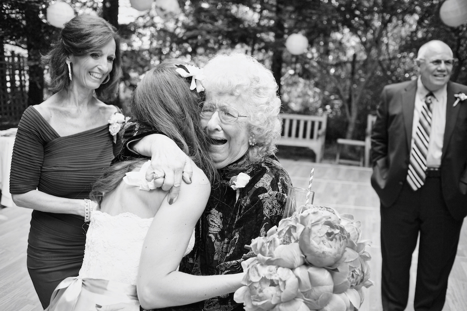 adorable grandmother hugging bride